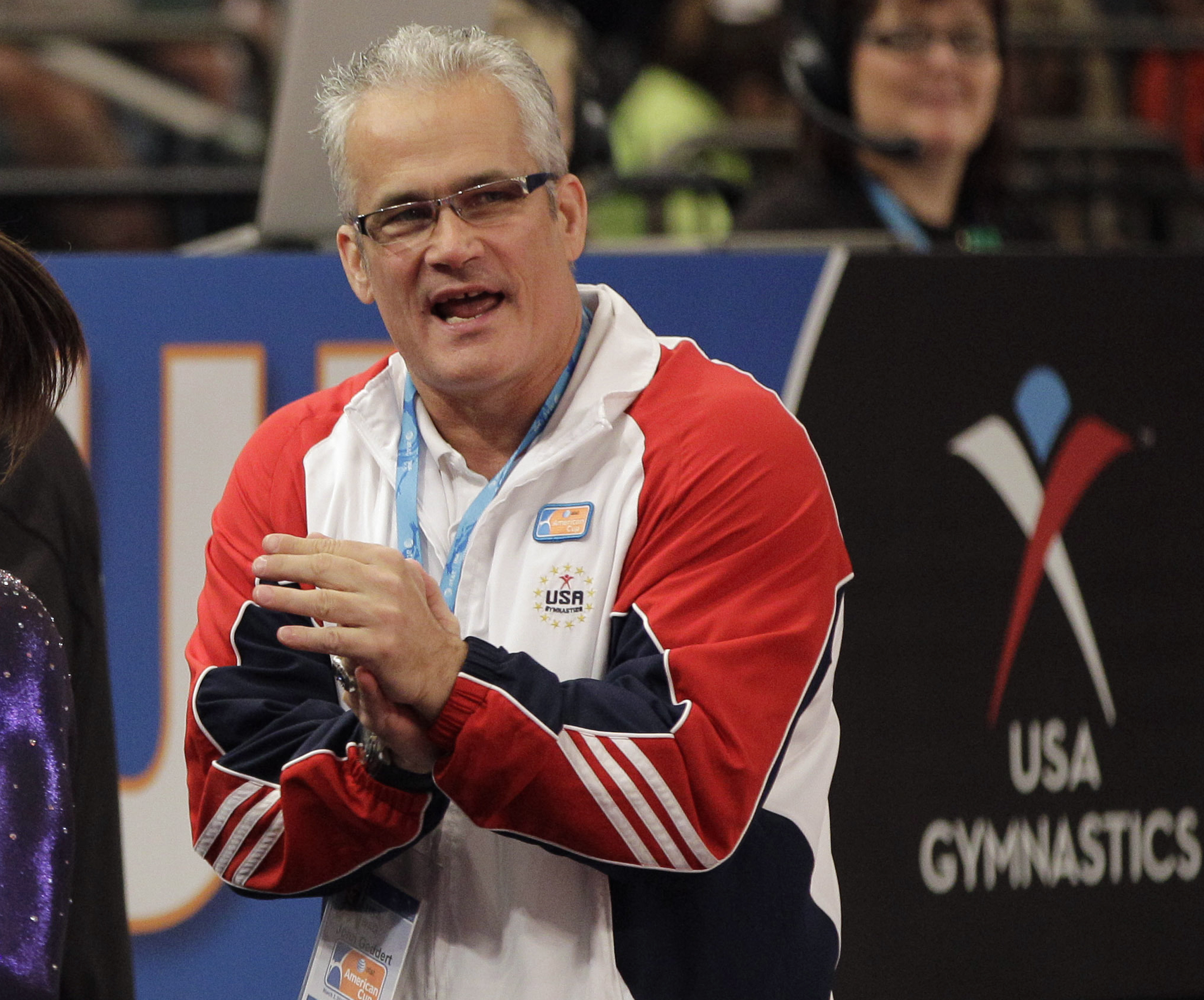 In this March 3, 2012, file photo, gymnastics coach John Geddert is seen at the American Cup gymnastics meet at Madison Square Garden in New York. Prosecutors in Michigan filed charges Thursday, Feb. 25, 2021, against Geddert, a former U.S. Olympics gymnastics coach with ties to disgraced sports doctor Larry Nassar. Geddert was head coach of the 2012 U.S. women's Olympic gymnastics team, which won a gold medal.