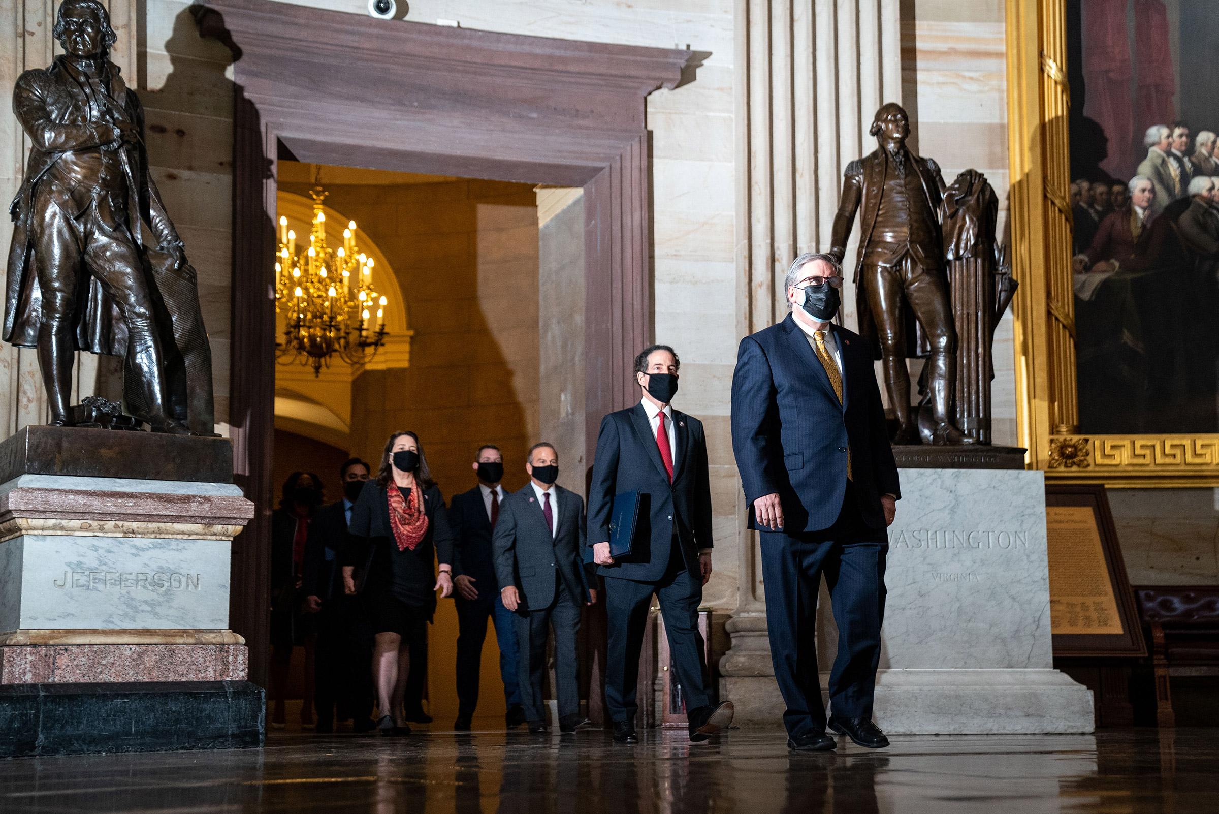 House impeachment managers, lead by Rep. Jamie Raskin, walk through the Rotunda of the U.S. Capitol in Washington on Feb. 9, 2021.