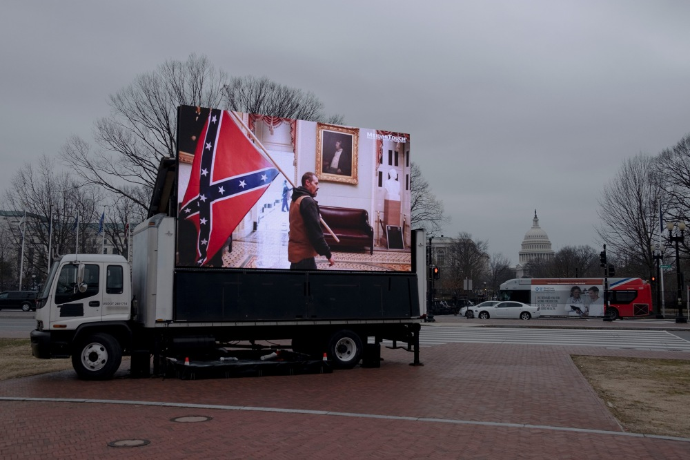 2/10/21, Washington, D.C. A truck showing scenes from the insurrection is parked outside Union Station during the impeachment trial of former president Donald Trump in Washington, D.C. on Feb. 10, 2021. Gabriella Demczuk / TIME