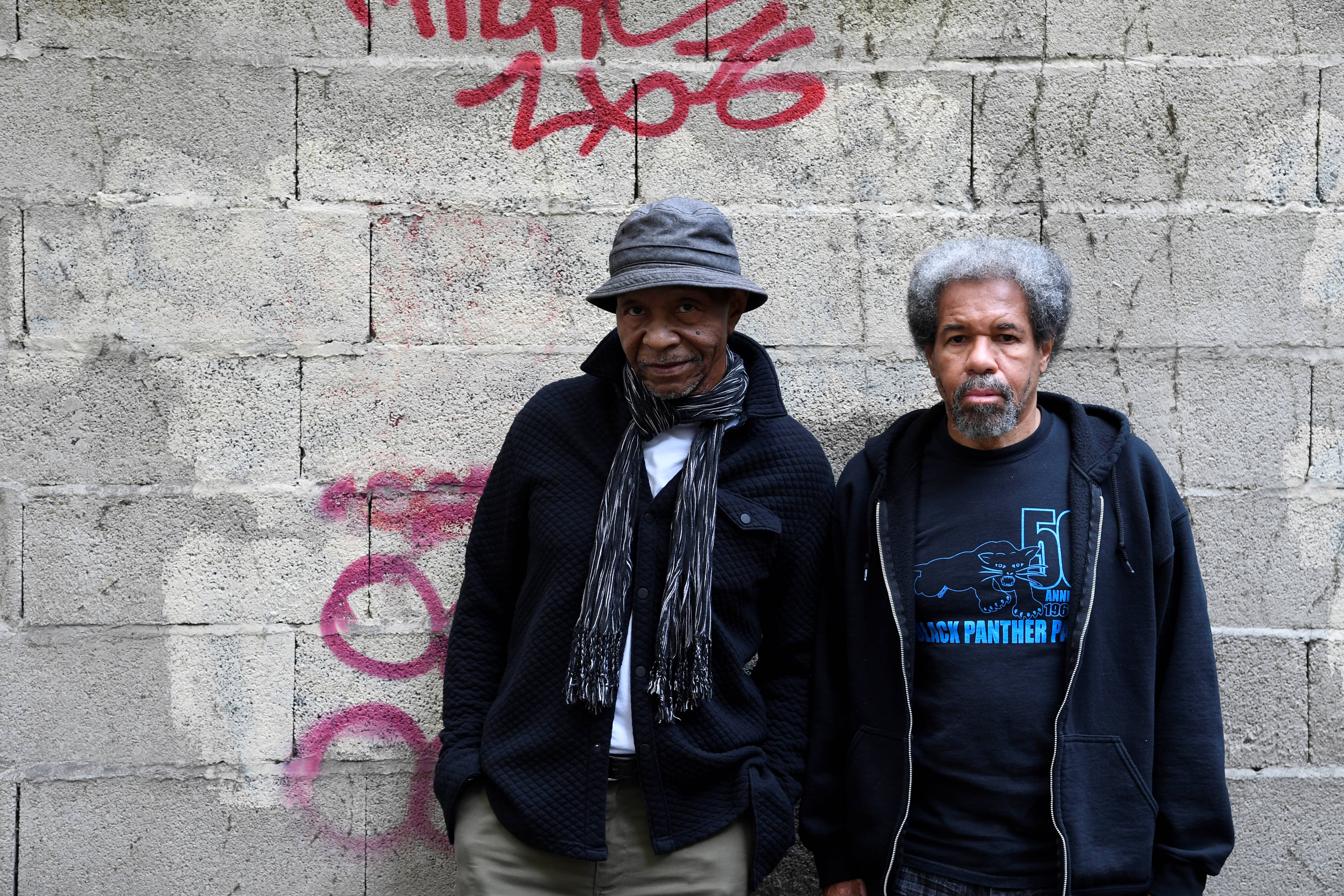 Former Louisiana State Penitentiary prisoners Robert King (R) and Albert Woodfox (L) pose prior to a press conference on Nov. 15, 2016 in Paris.