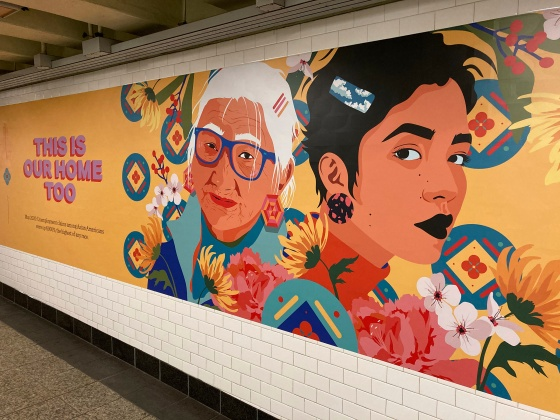 Posters against racism towards Asian Americans are seen at the subway station at Barclays Center in Brooklyn, Jan. 1
