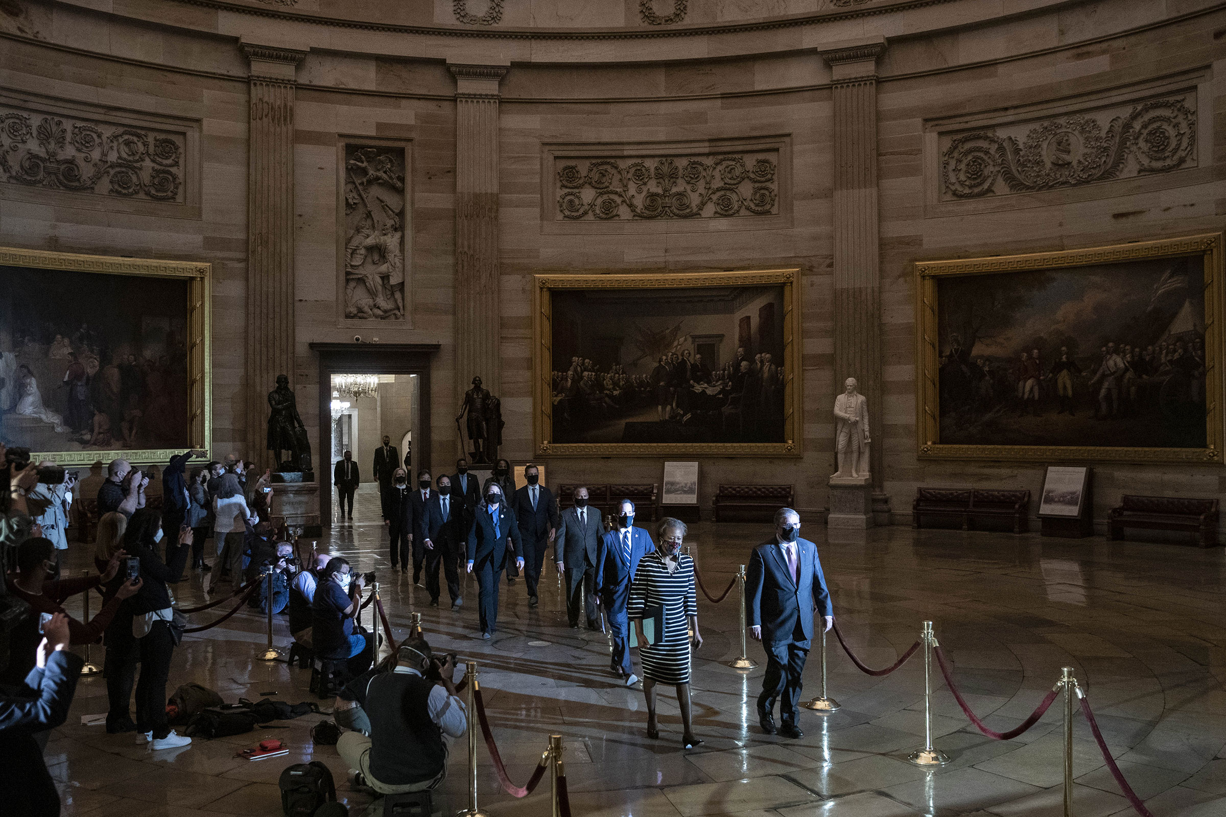 House managers walk the article of impeachment against President Donald Trump during a procession to the Senate Chamber in Washington, on Jan. 25, 2021.