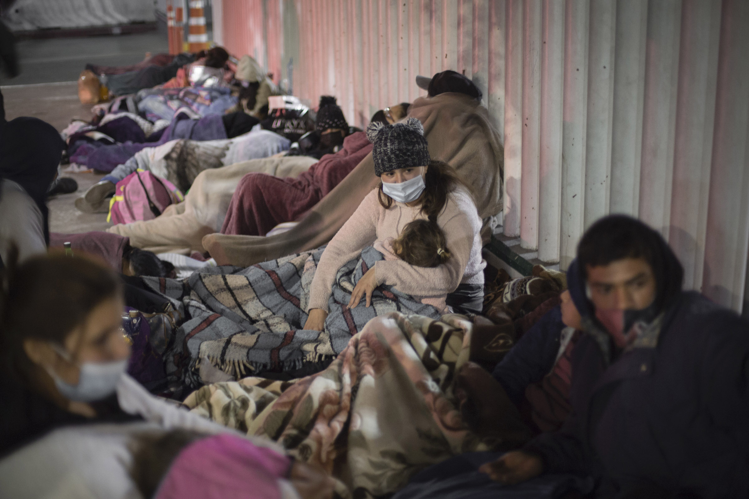 Dozens of migrants of Central American and Mexican origin sleep on the esplanade of the National Institute of Migration near the El Chaparral border crossing, waiting for U.S. authorities to let them enter to begin their humanitarian asylum process in this country on February 19.