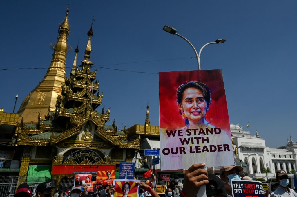 A protester holds a sign calling for the release of detained Myanmar civilian leader Aung San Suu Kyi during a demonstration against the military coup in Yangon on Feb. 17, 2021.