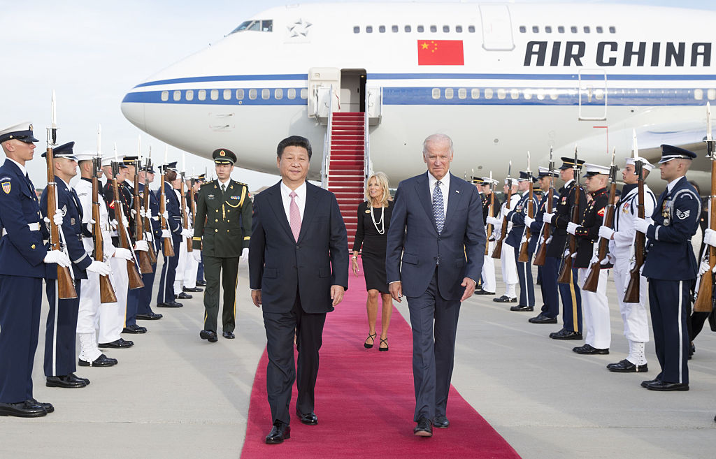 Chinese President Xi Jinping and his wife Peng Liyuan are welcomed by then-Vice President Joe Biden and Jill Biden at Andrews Air Force Base in Washington D.C., on Sept. 24, 2015.