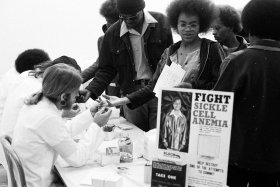 Black Panthers put on a Black Community Survival Conference, at the Civic Auditorium. April 1972, Bags of groceries are given away, and participants can also take sickle cell anemia tests and register to vote