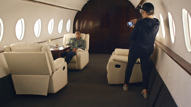 Chris Bailey, left, and Nick Bilton shoot photos in a faux private plane in 'Fake Famous'