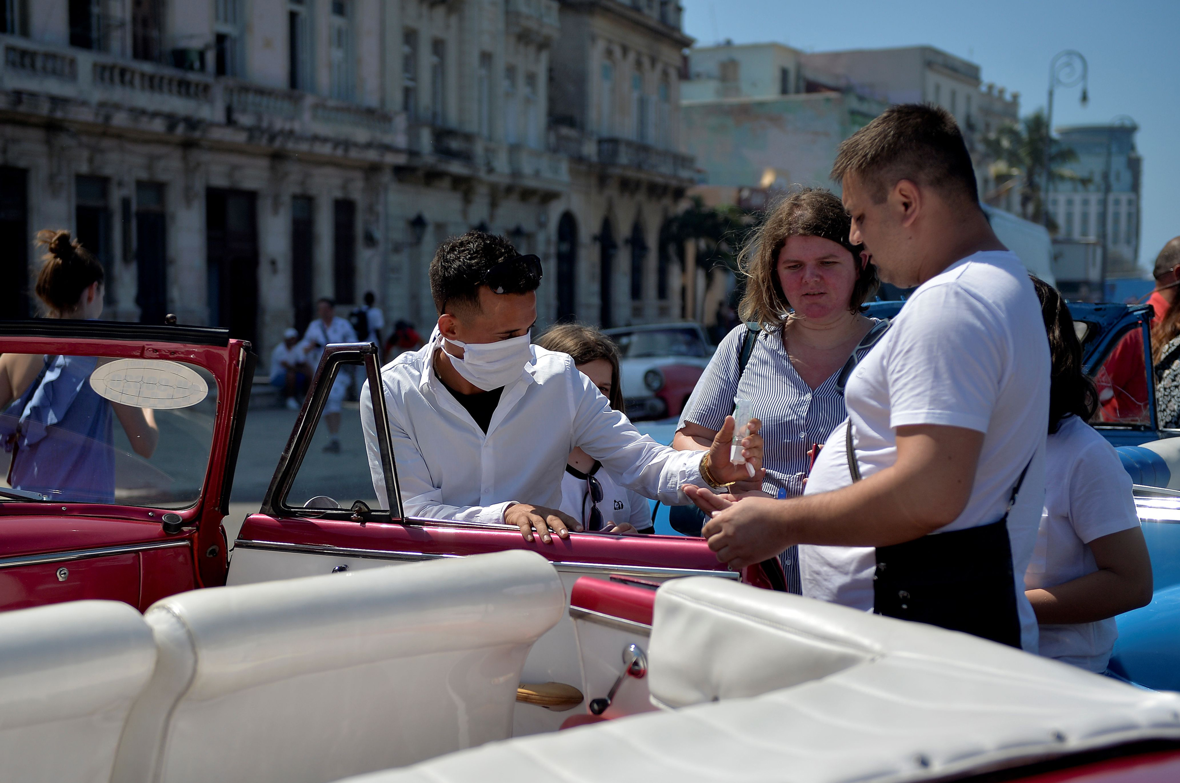 A private taxi driver getting ready to drive tourists around Havana, on March 19, 2020.