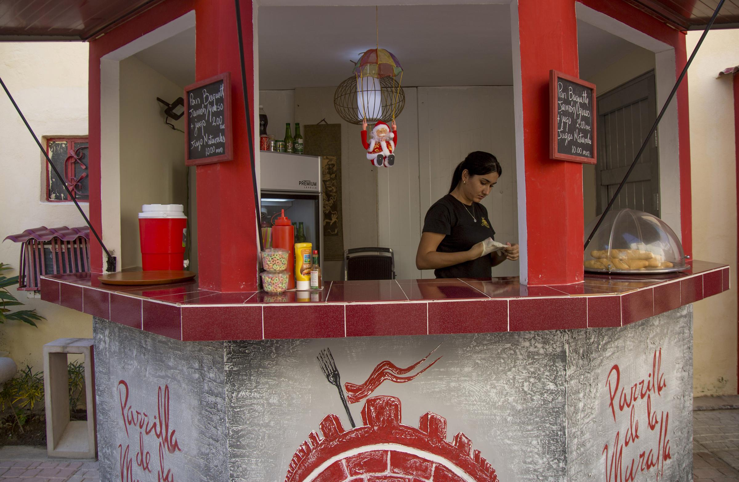 Alexa Garcia works at a cafe in Chinatown in Havana on Jan. 13, 2020.