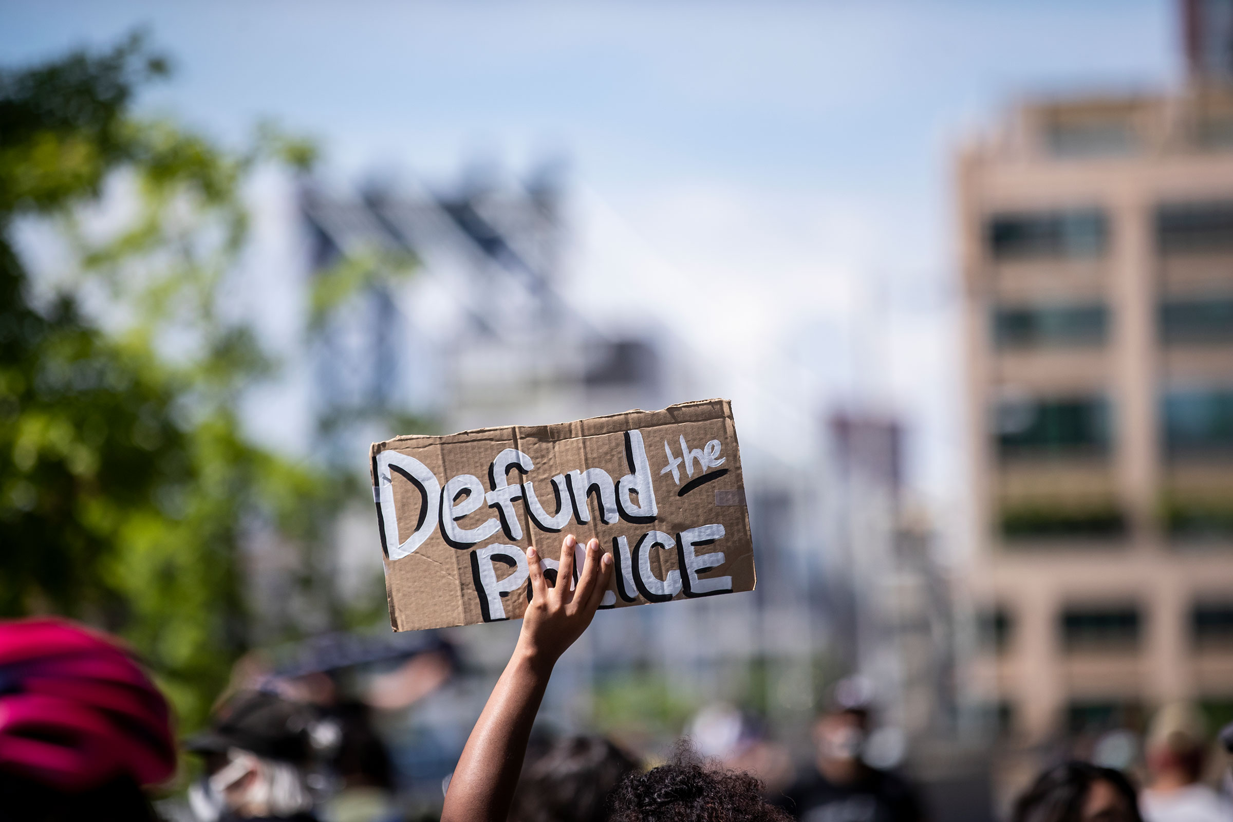 A protester holds up a homemade sign that says,  Defund the Police  during a peaceful protest in New York City June 19, 2020.