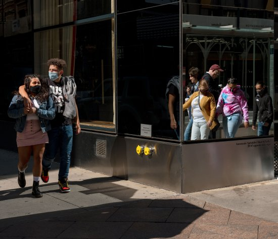 People wearing masks walk in Midtown Manhattan, at 45th st, and 5th ave on Oct. 3, 2020.