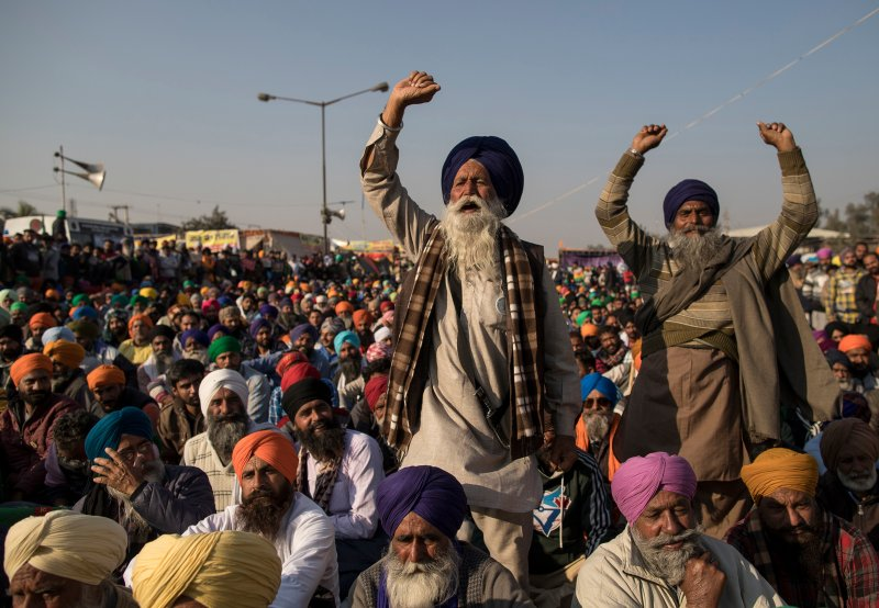Farmers shout slogans as they participate in a protest at the Delhi Singhu border in Delhi, India on Dec. 18, 2020.