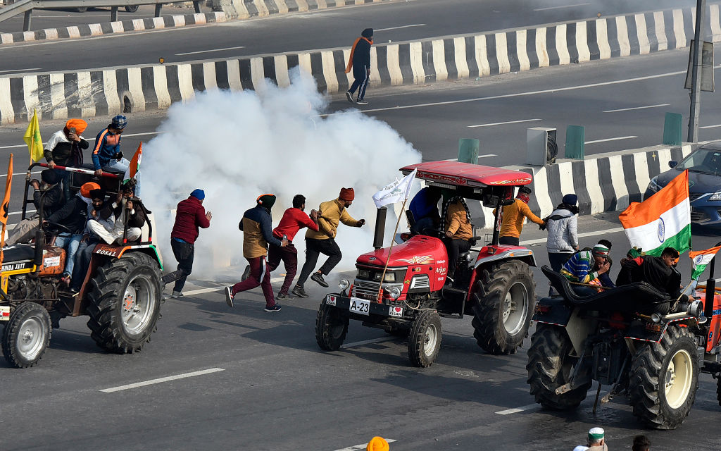 Demonstrators are tear-gassed during the farmers' tractor rally on January 26, 2021 in New Delhi, India.