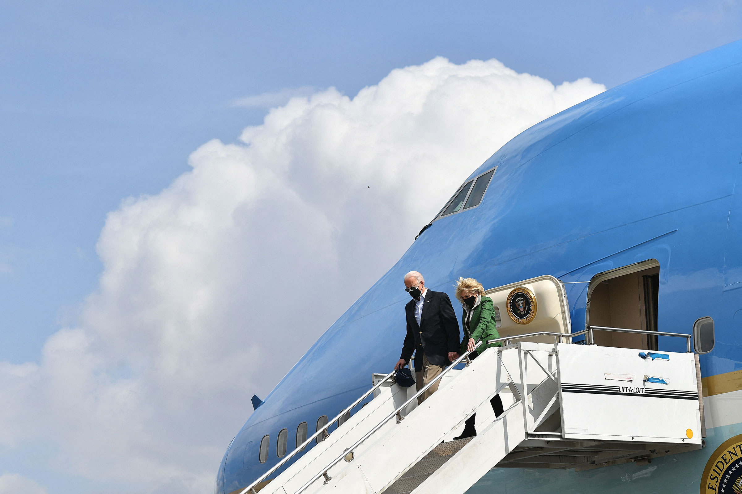 President Joe Biden and First Lady Jill Biden step off Air Force One upon arrival at Ellington Field Joint Reserve Base in Houston, Texas on Feb. 26, 2021.