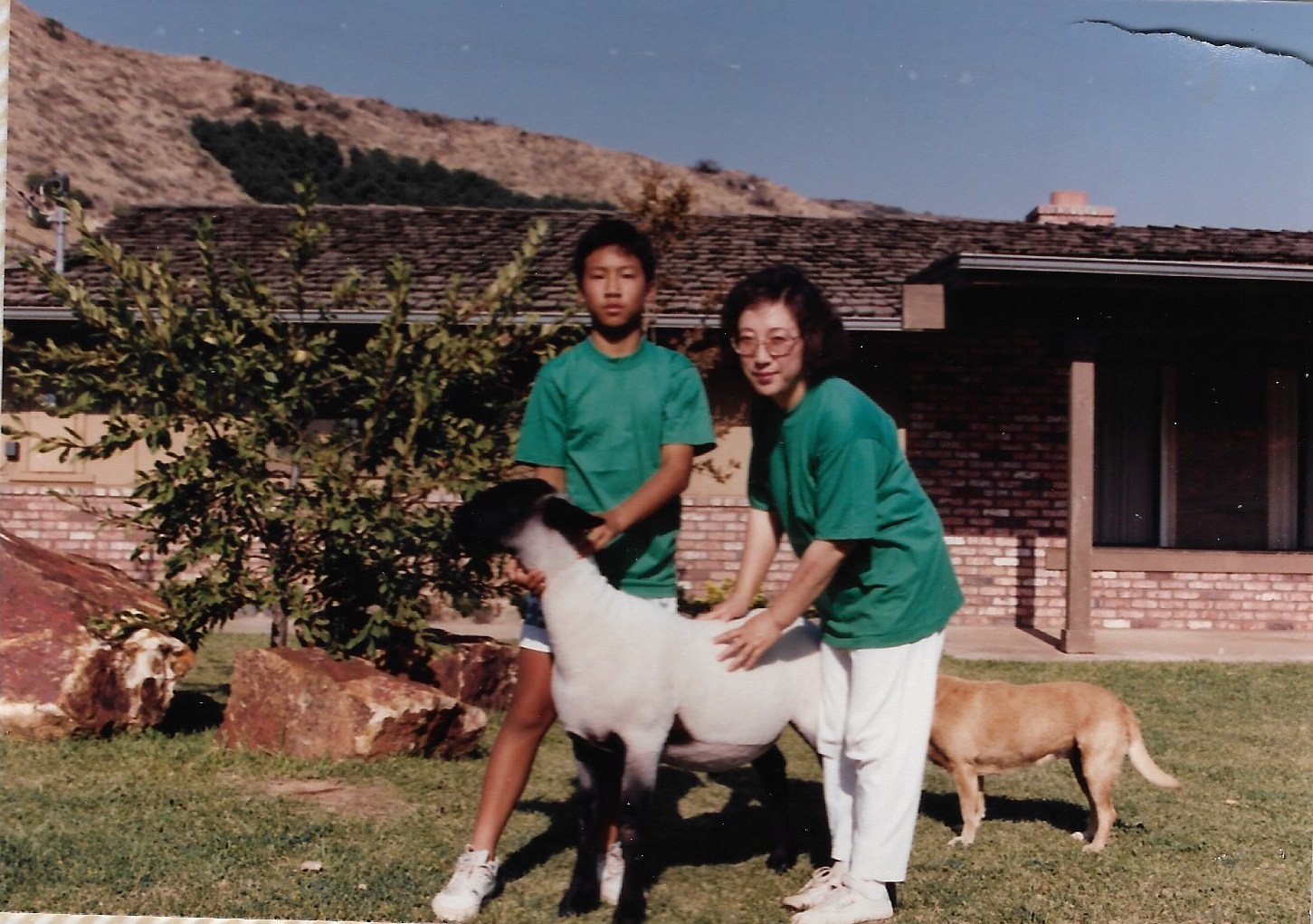 Joseph Chong, left, with his mother Sun Ok Chong on their California farm in the 1980s.