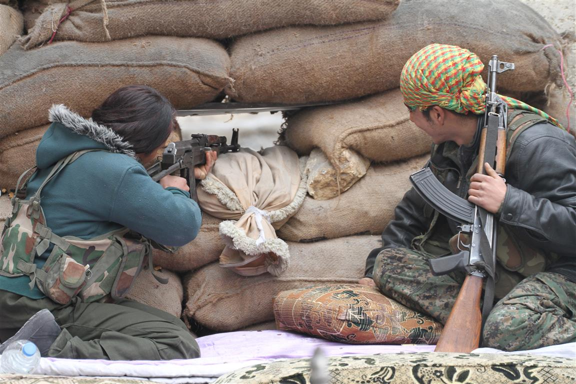 Two fighters defending Kobani during the battle for Kobani, Syria, in Sept. 2014.
