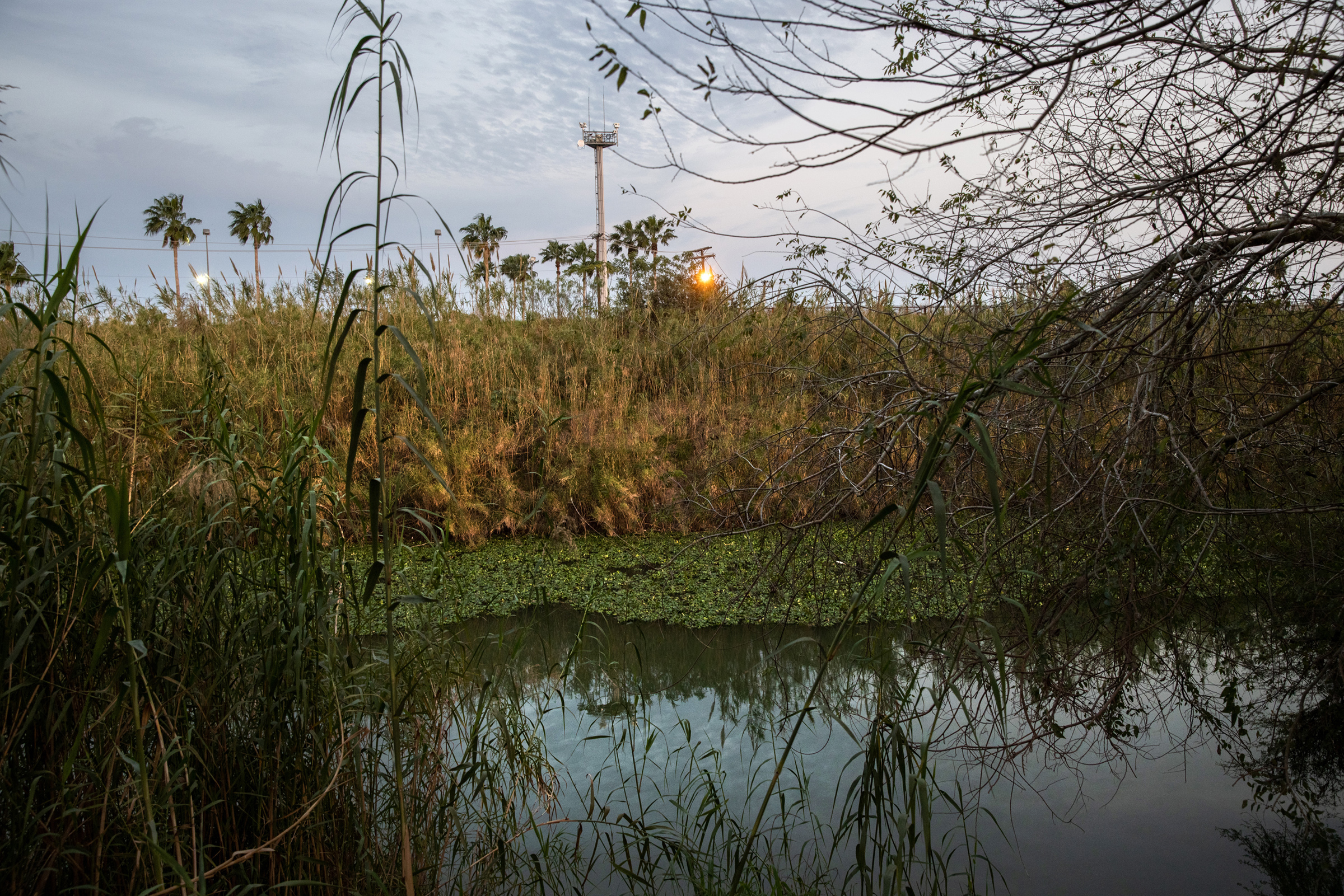 A U.S. Border Patrol surveillance tower stands on the other side of the Rio Grande in Matamoros, Mexico, on Feb. 7, 2021.