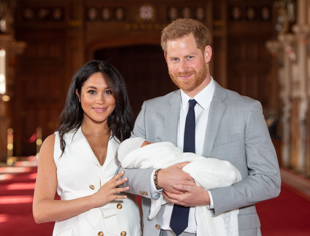 Prince Harry, Duke of Sussex and Meghan Markle, Duchess of Sussex, pose with their newborn son Archie Harrison Mountbatten-Windsor during a photocall in St George's Hall at Windsor Castle on May 8, 2019 in Windsor, England.