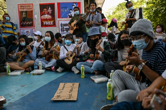 Musicians take part in a demonstration against the military coup in Yangon on Feb. 11