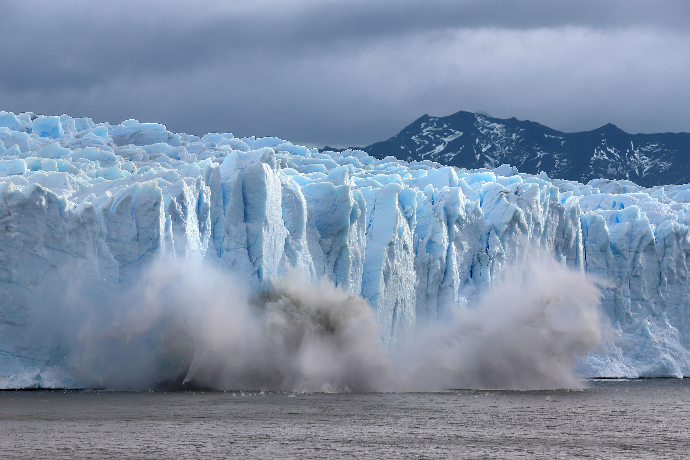 A piece of the Perito Moreno glacier, part of the Southern Patagonian Ice Field, breaks off and crashes into Lake Argentina in the Los Glaciares National Park in Santa Cruz province, Argentina on April 5, 2019. In 2019, the ice fields were the largest expanse of ice in the Southern Hemisphere outside of Antarctica, but according to NASA reporting they were melting away at some of the highest rates on the planet as a result of global warming.