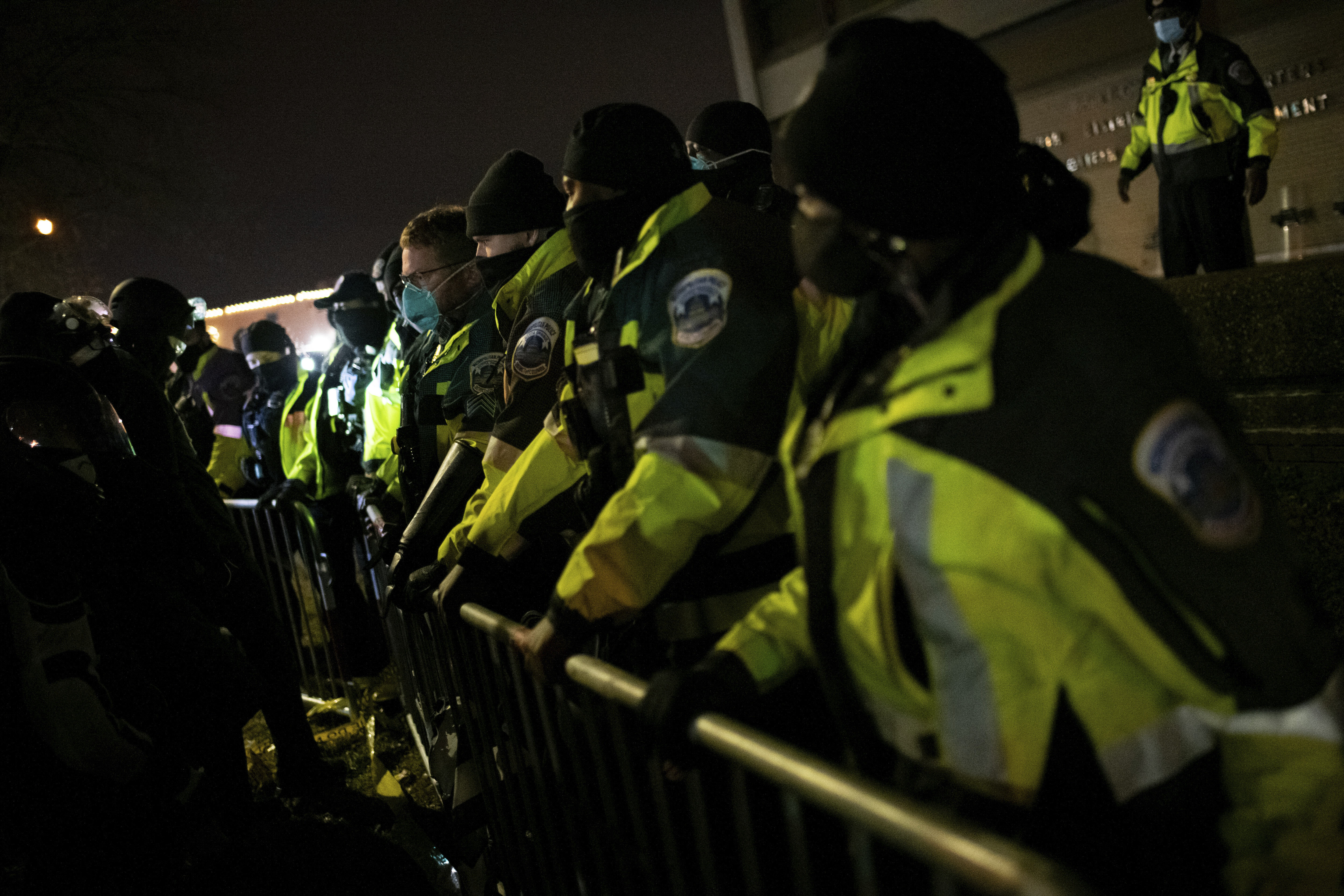 Police officers face off with protesters in Washington, D.C. on Dec. 19, 2020.