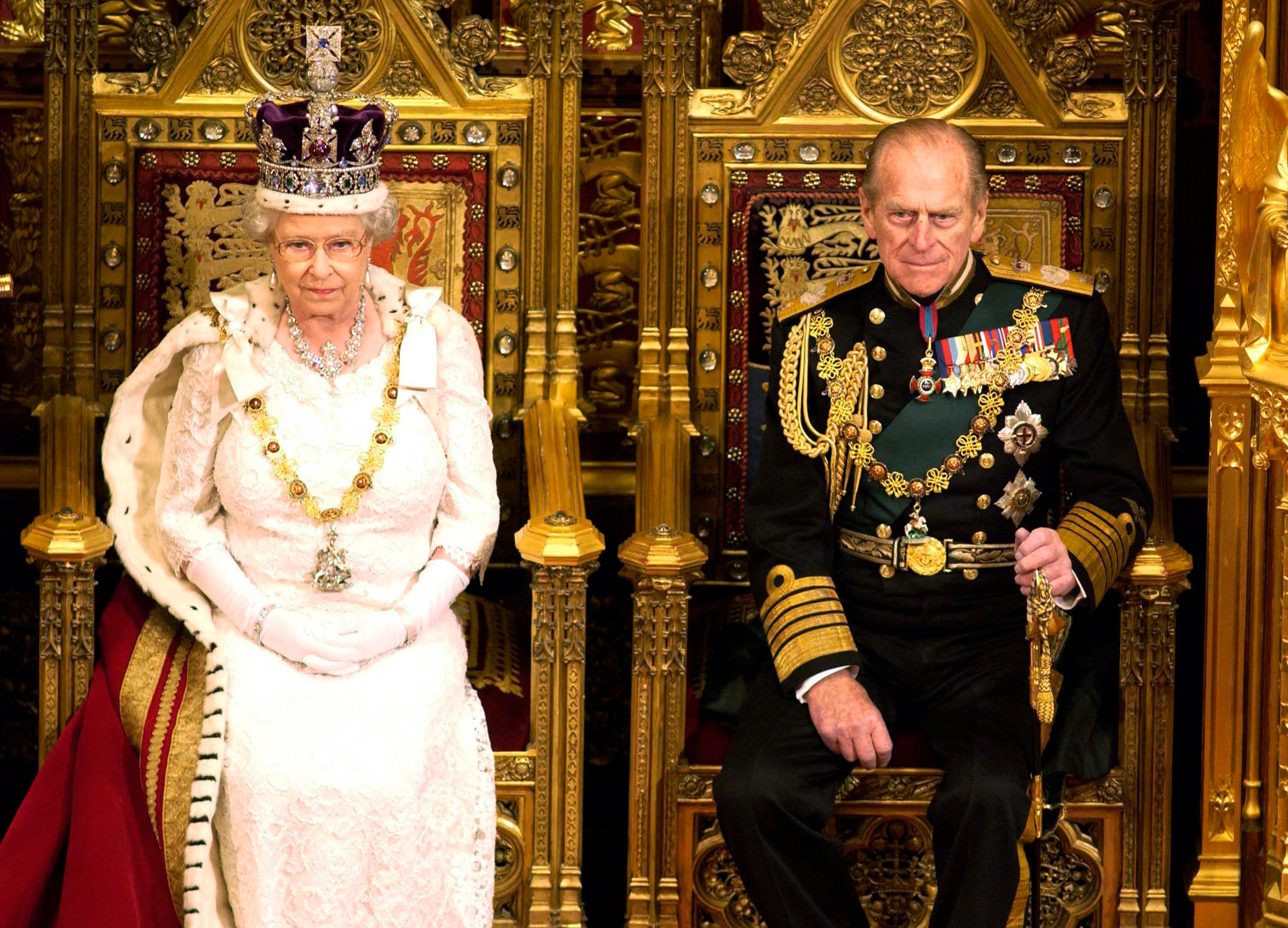Queen Elizabeth II sits with Prince Philip in the House of Lords during the State Opening of Parliament on Nov. 26, 2003.