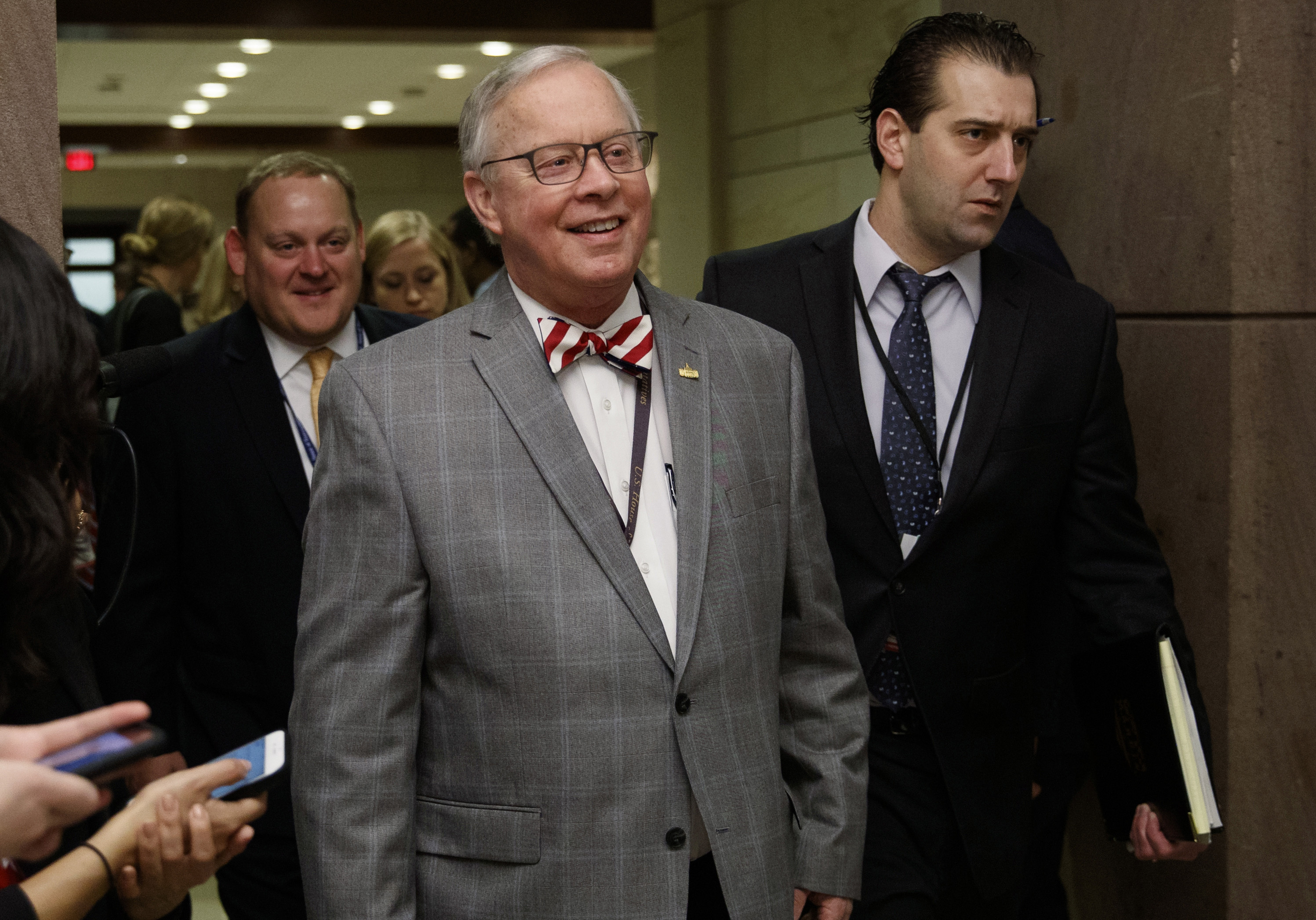 U.S. Rep. Ron Wright, R-Texas, walks to a session during member-elect briefings and orientation on Capitol Hill in Washington.
