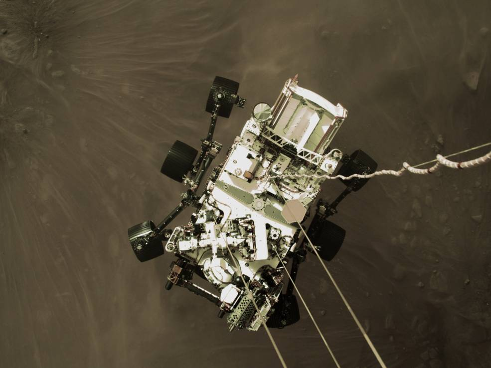 The Perseverance rover is lowered to the surface of Mars on Feb. 18 in image captured by the spacecraft's descent stage.