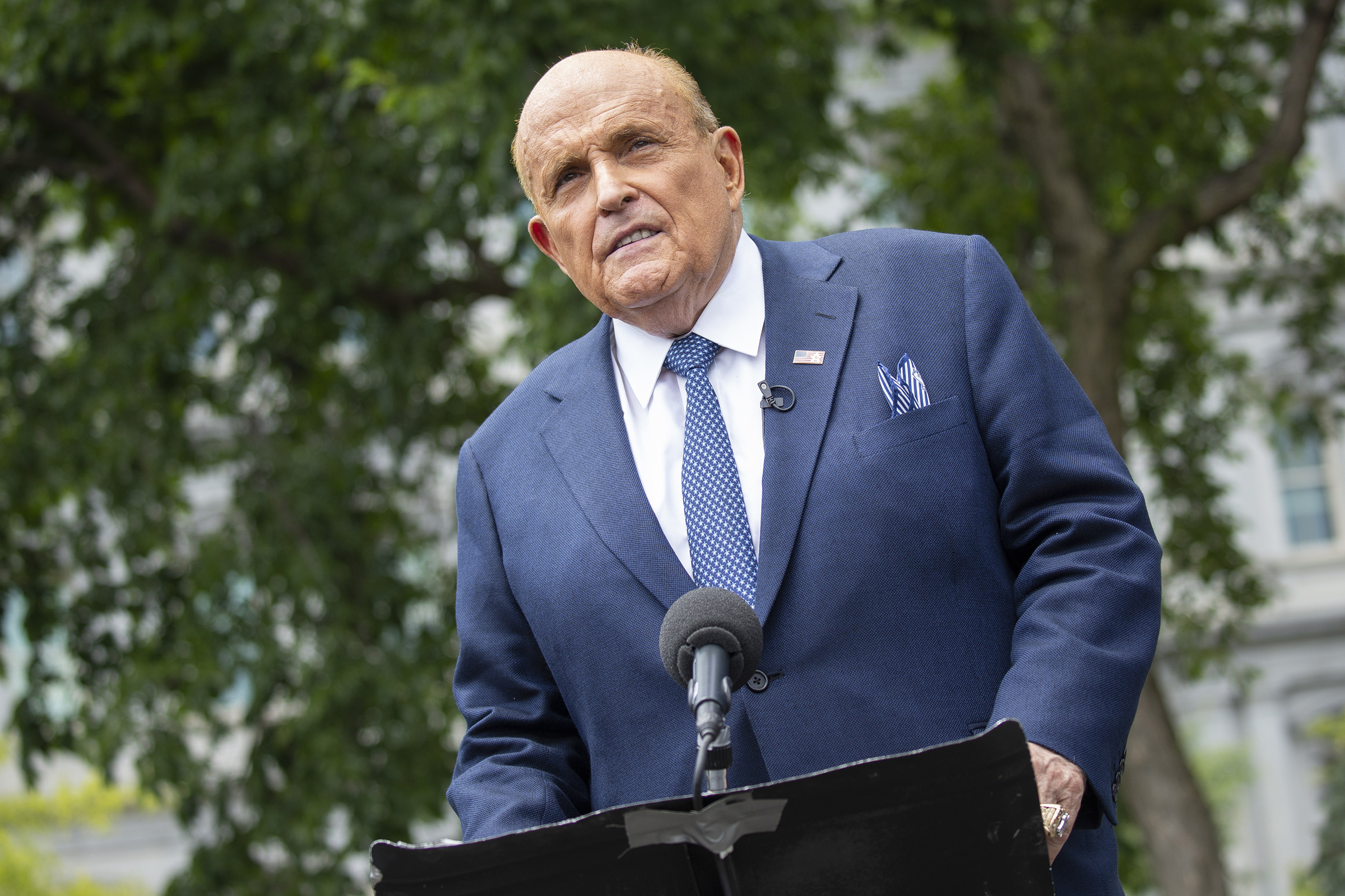 President Donald Trump's lawyer and former New York City Mayor Rudy Giuliani pauses while speaking to members of the media outside the White House in Washington, D.C., on July 1, 2020.