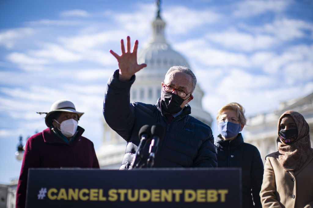 Senate Majority Leader Chuck Schumer, a Democrat from New York, speaks during a news conference on student loan debt in front of the U.S. Capitol in Washington, D.C., U.S., on Thursday, Feb. 4, 2021. House Democrats are heading into a showdown with Republicans today over GOP Representative Marjorie Taylor Greene's past promotion of conspiracies that threatens to provoke an escalating cycle of political retaliation.