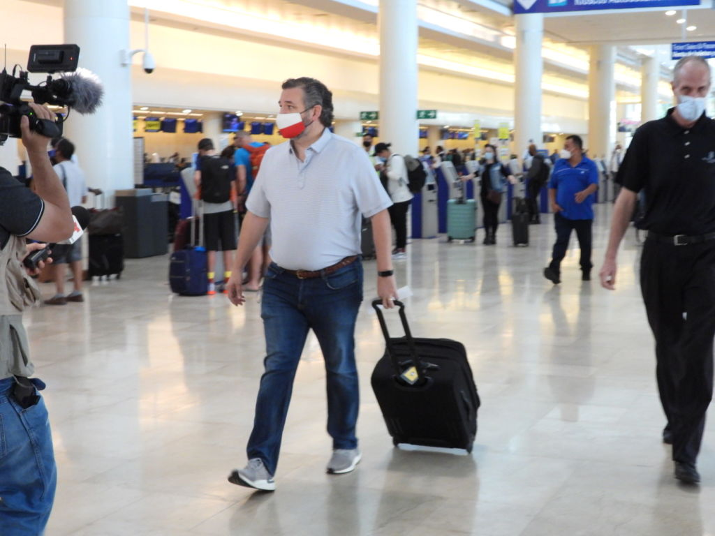 Texas Sen. Ted Cruz checks in for a flight at Cancun International Airport after a backlash over his trip to Mexico with his family as his home state of Texas endured a Winter storm on Feb. 18, 2021.