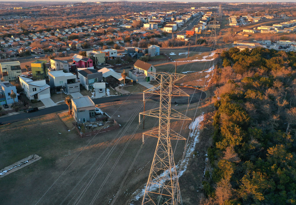 An aerial view from a drone shows electrical lines running through a neighborhood on Feb. 19, 2021 in Austin, Texas.