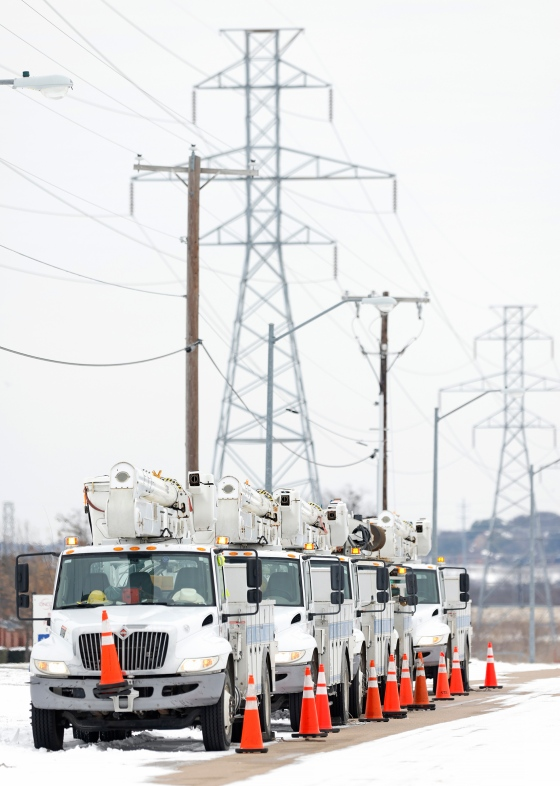 Electric service trucks line up in FortWorth after a snowstorm left millions of Texans without power