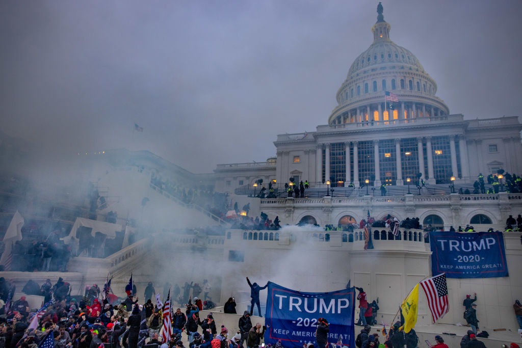 WASHINGTON,DC-JAN6: Tear gas is fired at supporters of President Trump who stormed the United States Capitol building.