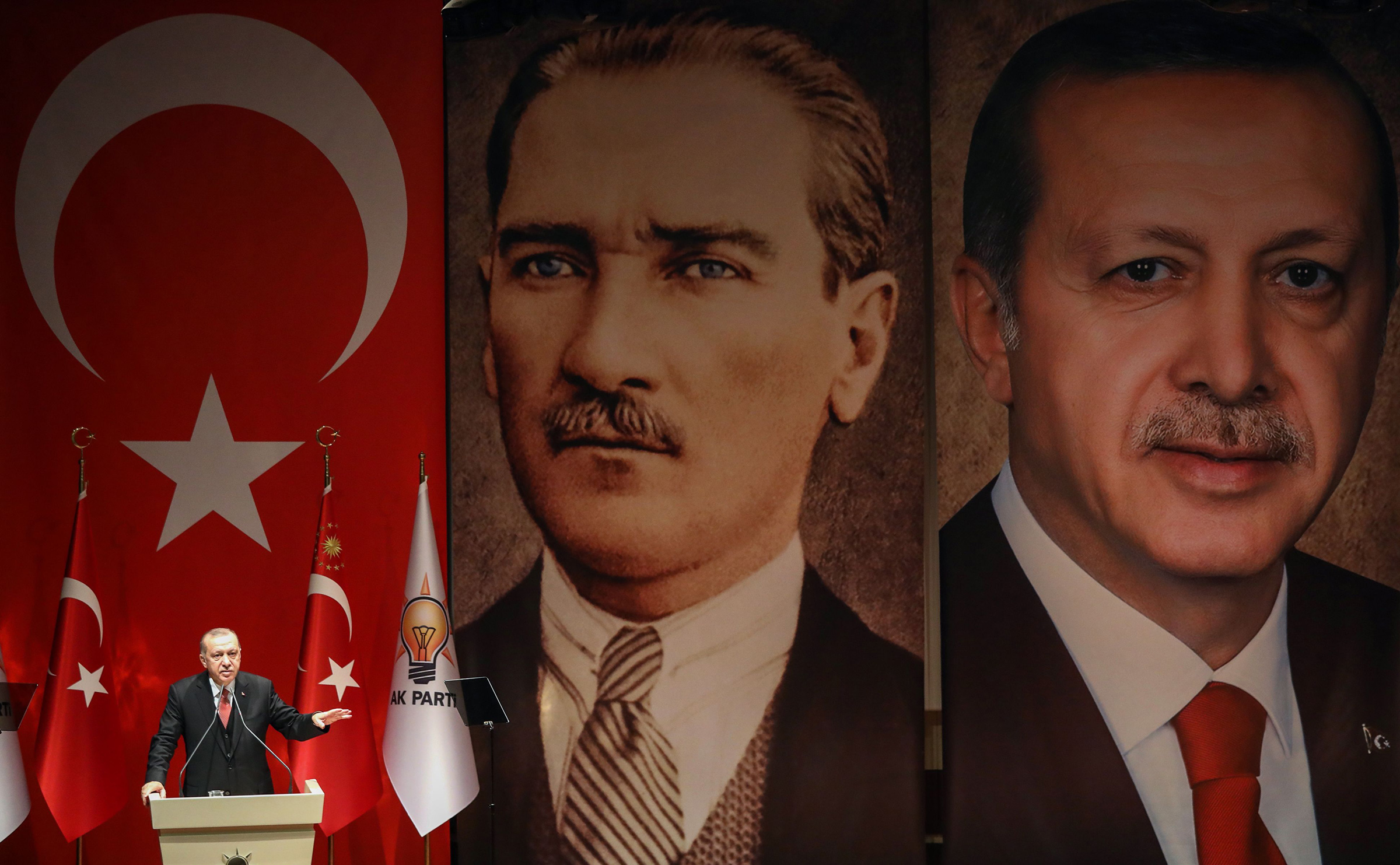 Turkish President Recep Tayyip Erdogan addresses a meeting of election officials in front of portraits of himself and Mustafa Kemal Ataturk, the founder of modern Turkey, in Ankara on Jan. 29, 2019.