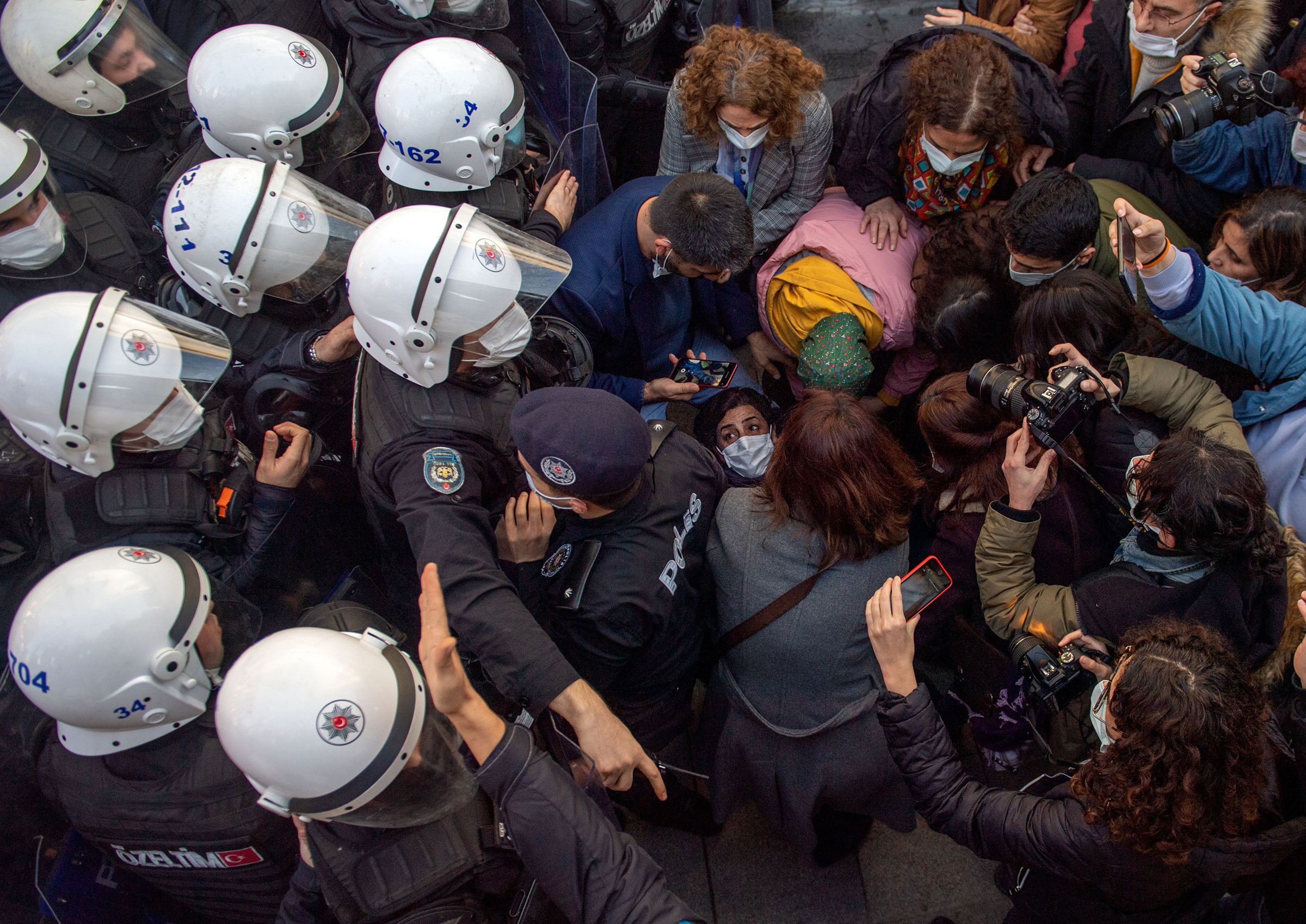 Turkish police officers detain people over protests in Istanbul against President Tayyip Erdogan's appointment of a new rector at Bogazici University on Feb. 4, 2021.