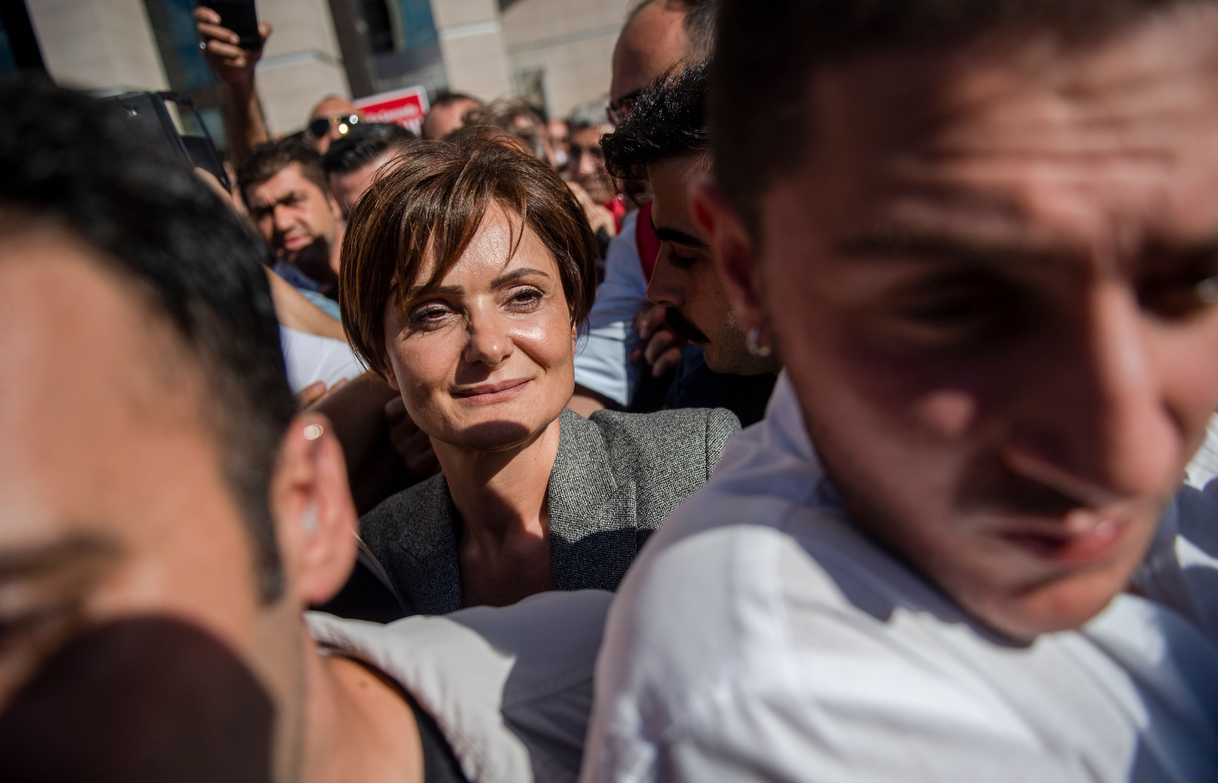 Dr. Canan Kaftancioglu, center, leaves the Caglayan courthouse in Istanbul on Sept. 6, 2019.