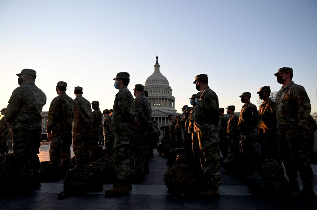 Members of the US National Guard arrive at the US Capitol on January 12, 2021 in Washington, DC. - The Pentagon is deploying as many as 15,000 National Guard troops to protect Biden's inauguration on January 20, amid fears of new violence.