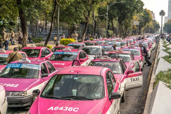 Taxi drivers in Mexico City protest on Oct.12 over the rise of foreign ride-share apps including Uber and DiDi