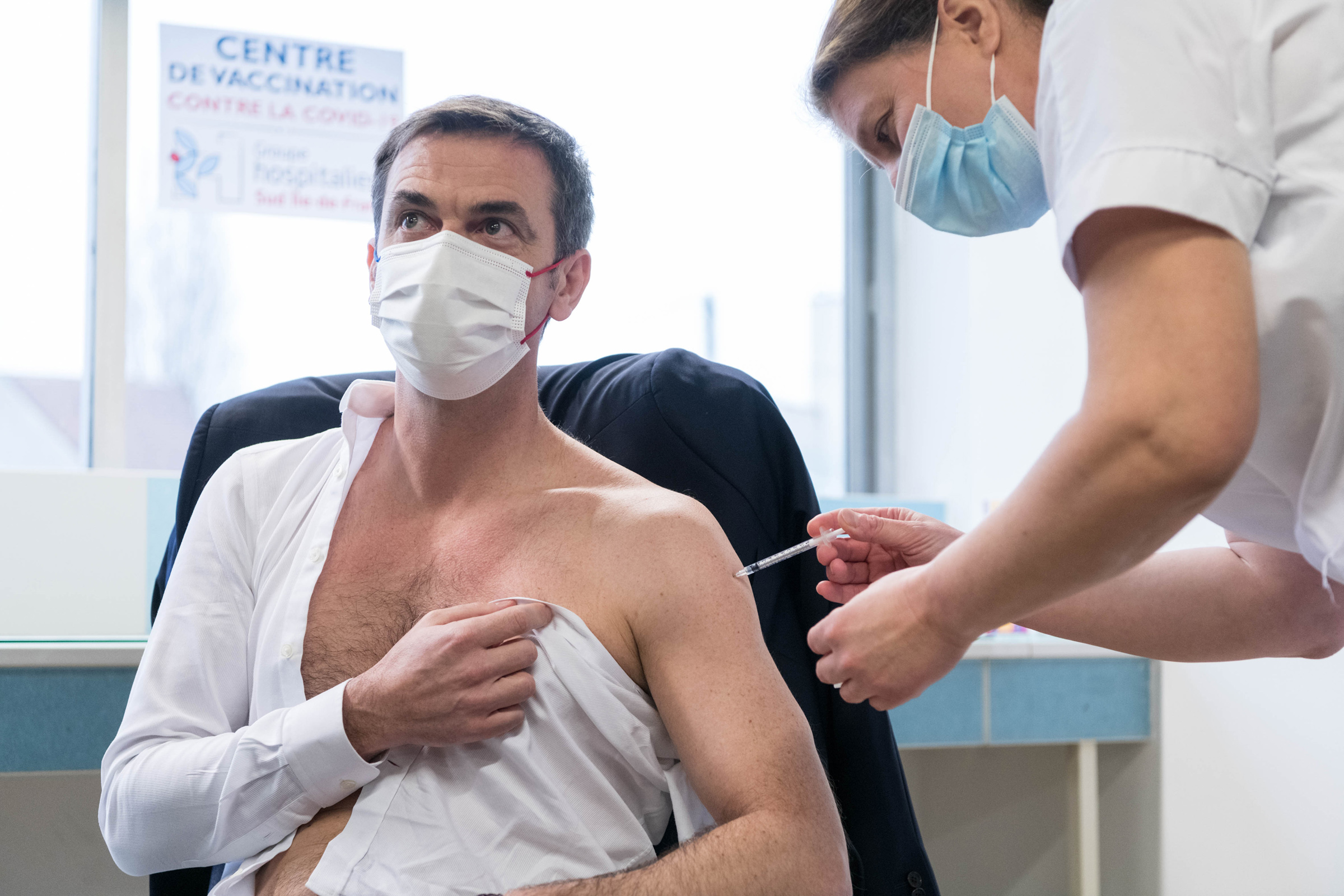 French Health Minister Olivier Veran receives the first injection of the AstraZeneca vaccine against COVID-19 in a hospital in Melun, France, on Feb. 8, 2021.