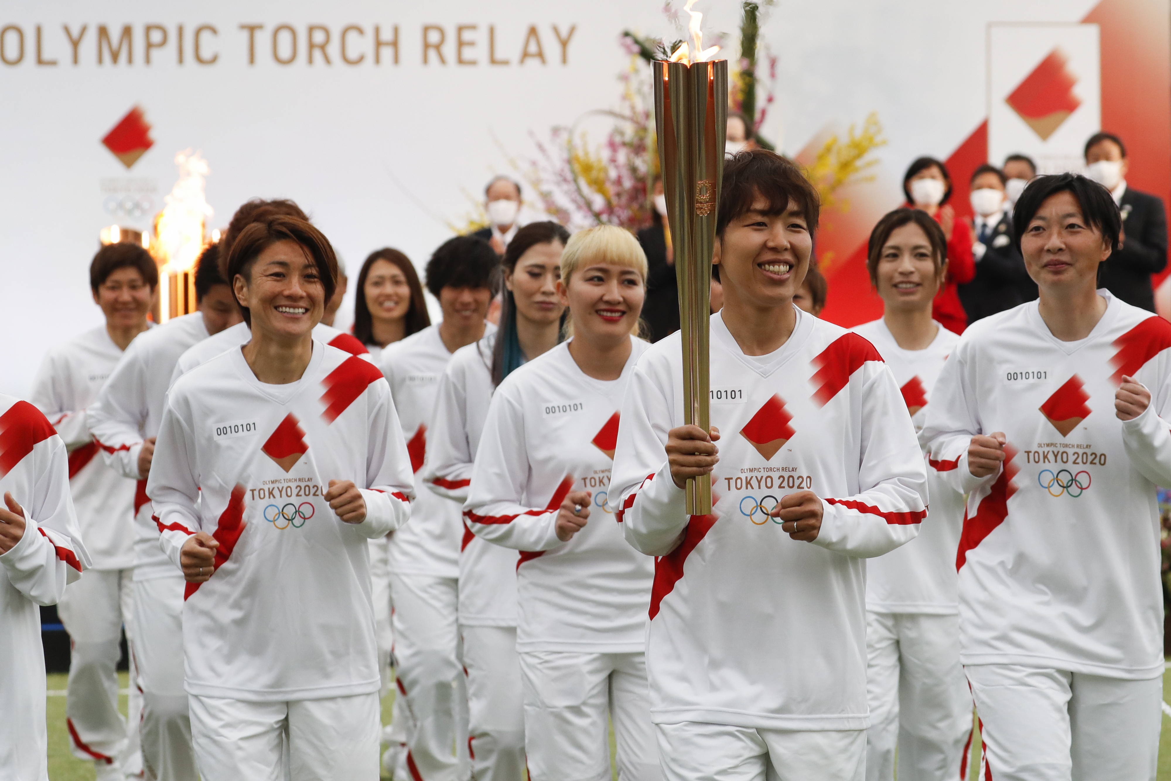 The women's national soccer team of Japan begin the the Tokyo 2020 Olympics Torch Relay in Naraha, Fukushima prefecture, northeastern Japan, on Thursday, March 25, 2021.