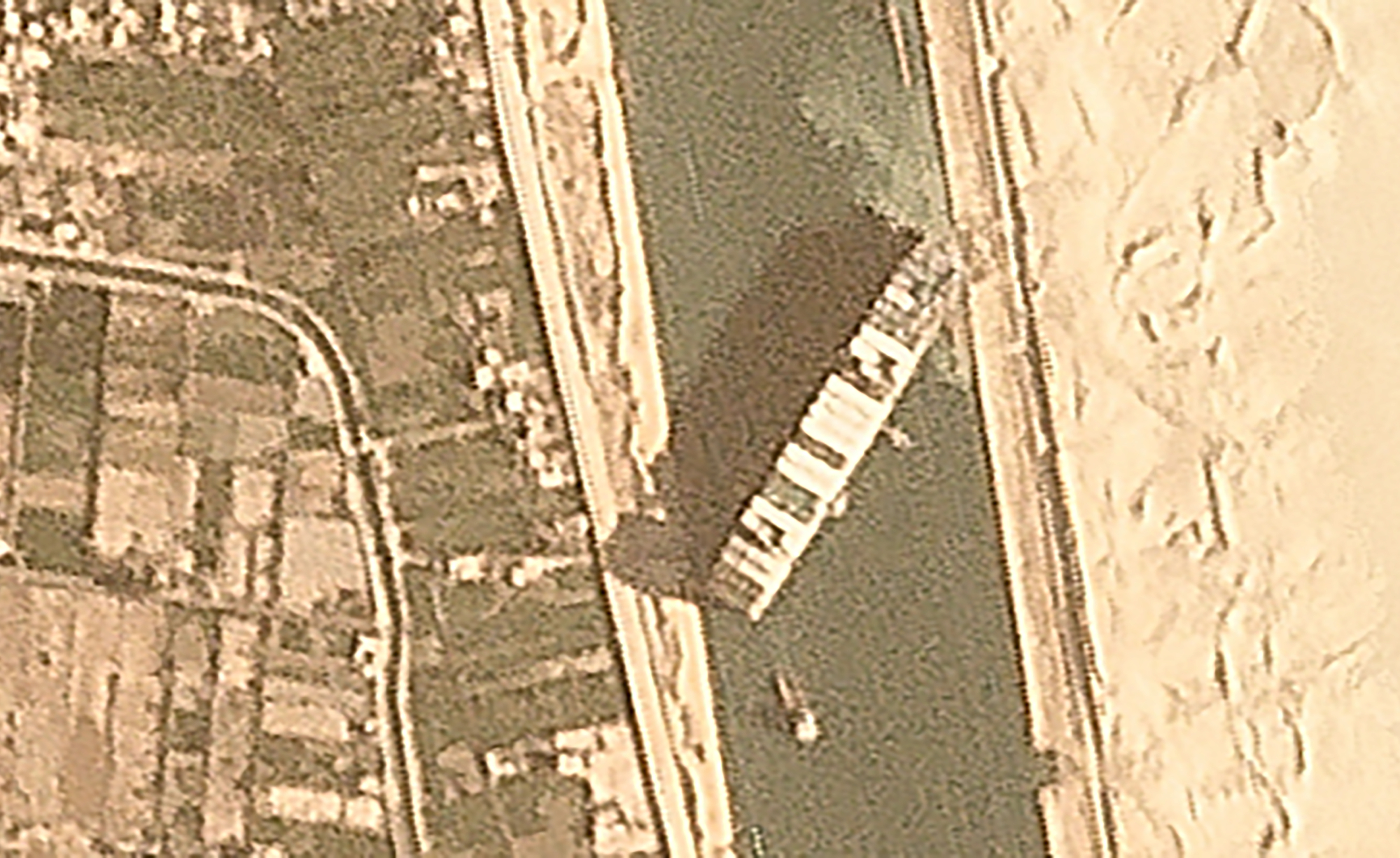 In this satellite image from Planet Labs Inc. the cargo ship MV Ever Given sits wedged in the Suez Canal near Suez, Egypt, Thursday, March 25, 2021.