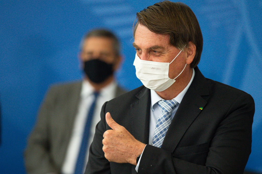 Jair Bolsonaro, Brazils president, gestures during a bill signing ceremony at the Planalto Palace in Brasilia, Brazil, on Wednesday, March 10, 2021.