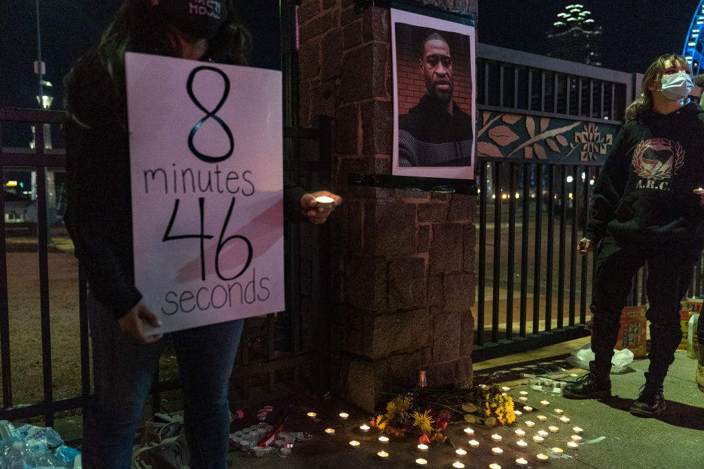 Demonstrators hold a vigil in honor of George Floyd on March 8, 2021 in Atlanta, Georgia. Jury selection was paused today in the trial of former Minneapolis police officer Derek Chauvin, who is charged in Floyd's death.