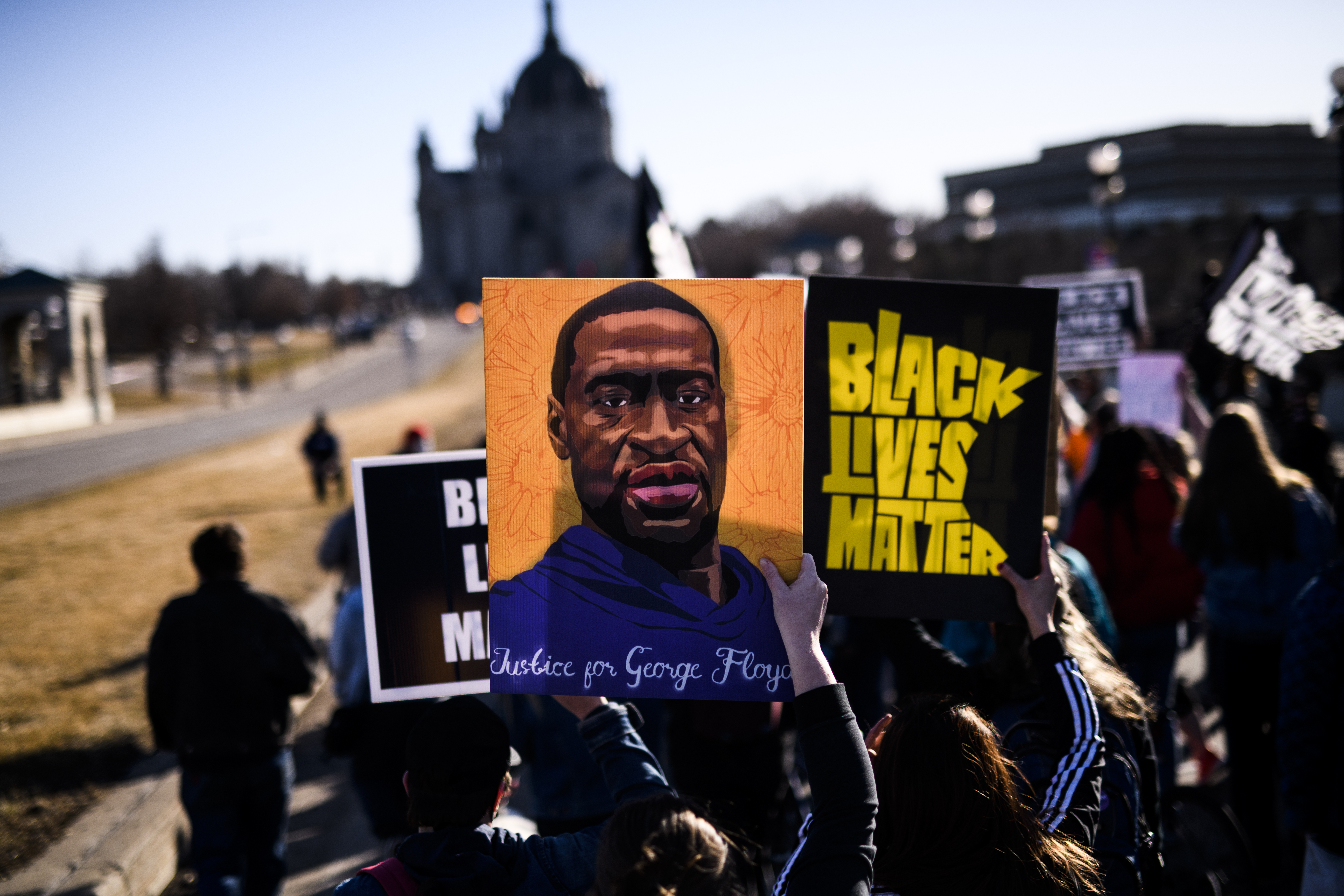 People march near the Minnesota State Capitol to honor George Floyd on March 19, 2021 in St. Paul, Minnesota.