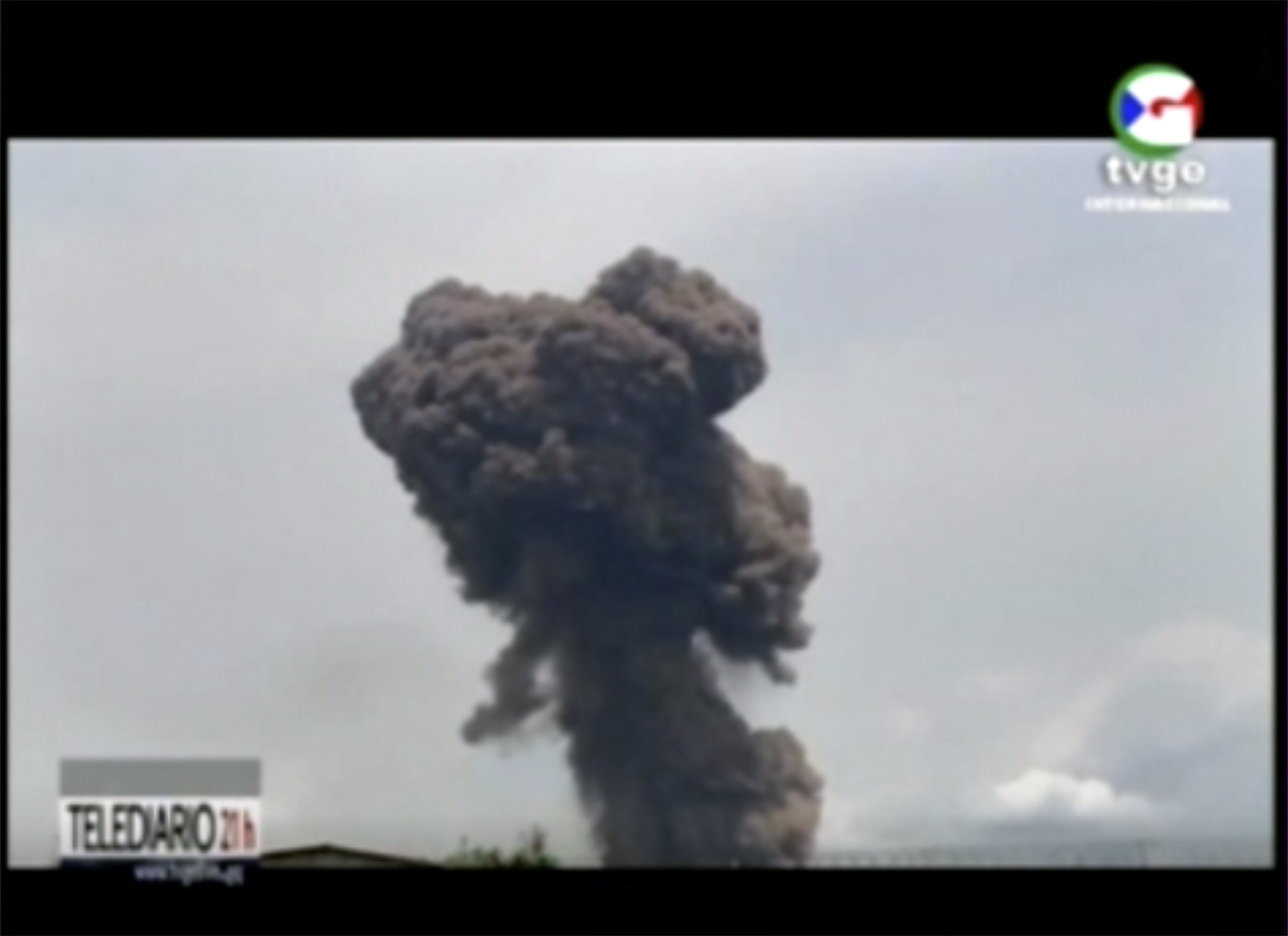 This TVGE image made from video shows smoke rising over the blast site at a military barracks in Bata, Equatorial Guinea, Sunday, March 7, 2021. A series of explosions killed at least 20 people and wounded more than 600 others on Sunday, authorities said.