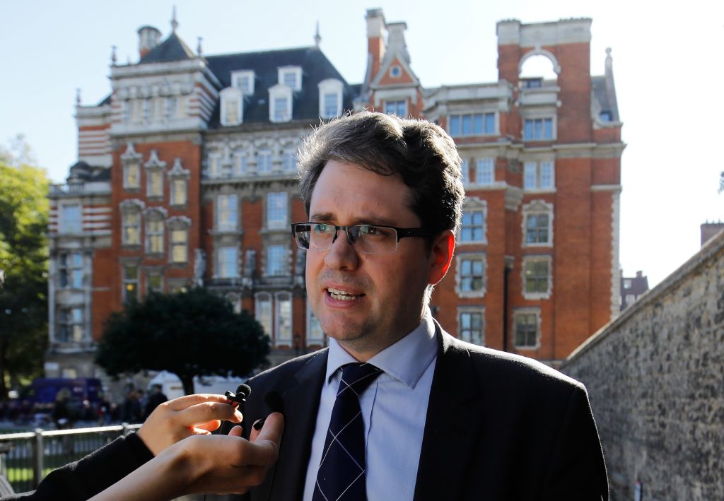 Eliot Higgins, founder of online investigation group Bellingcat, speaks to the media on College Green in London on October 9, 2018 after making a presentation in parliament on their investigation into the suspects of the Sergei Skripal poisoning.