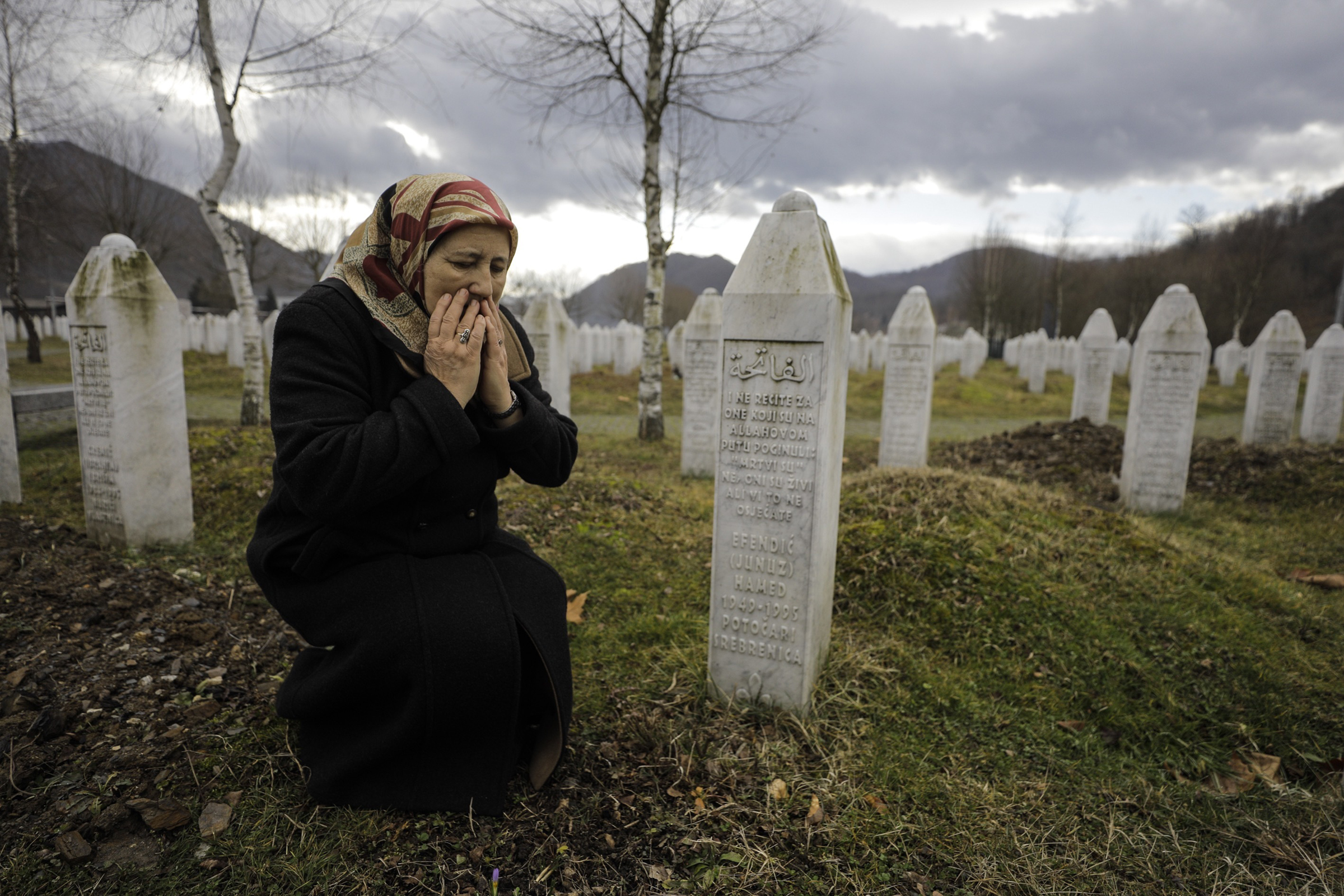 Mother of a Srebrenica victim Fazila Efendic, the mother of a Srebrenica victim visits the graves of her husband and son in Srebrenica, Bosnia, on Feb. 15, 2020. They lost their lives in the Srebrenica genocide, which started on July 11, 1995.