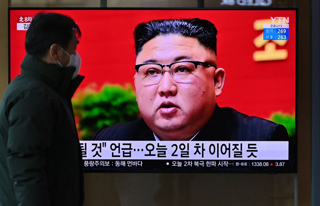 A man watches a television screen showing news footage of North Korean leader Kim Jong Un attending the 8th congress of the ruling Workers' Party held in Pyongyang, at a railway station in Seoul on January 6, 2021.