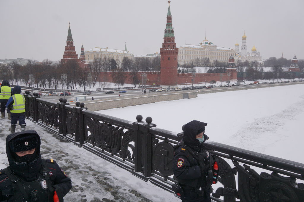 Russian police officers wearing face masks to protect themselves against the coronavirus (COVID-19) guard the bridge in front of the Kremlin, on February 24, 2021, in Moscow, Russia.